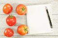 Cook Book Guide and tomato. Royalty Free Stock Photo