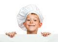 Cook boy is hiding behind a white sheet Stock Photo
