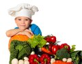 Cook boy six years old with different vegetables isolated on white Stock Image
