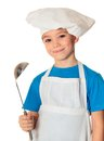 Cook boy six years old with ladle isolated on white Stock Photos