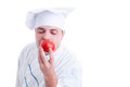 Cook or chef smelling fresh organic perfect red tomato Royalty Free Stock Photo