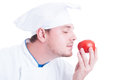 Cook or chef smelling small fresh organic perfect red tomato Royalty Free Stock Photo