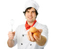 Cook with eggs man holds on awhite background Royalty Free Stock Image