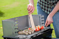 Cook grilling a delicious food in the garden Stock Images