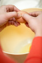 Cook hands cracking eggs making cookies Stock Photos