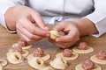 Cook hands sculpt dumplings with minced meat closeup Stock Photo