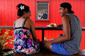 Cook islander couple rarotonga sep eat out in a local restaurant on sep the islands main population centres are on the island Stock Photo