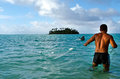 Cook islands fisherman fishing rarotonga sep net in muri beach on sep the has rights and responsibilities over Royalty Free Stock Photo