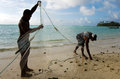 Cook islands fishermen fishing rarotonga sep net in muri beach on sep the has rights and responsibilities over Stock Image