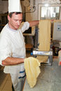 Cook making fresh egg pasta lugano switzerland may rolled in typical italian machine Stock Photography