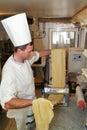 Cook making fresh egg pasta lugano switzerland may rolled in typical italian machine Stock Image