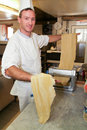 Cook making fresh egg pasta lugano switzerland may rolled in typical italian machine Royalty Free Stock Photo