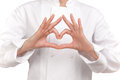 Cook making a sign with both hands representing a heart photograph of bust of Stock Photo