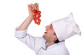 Cook man has cherry tomatoes Royalty Free Stock Images