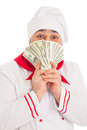 Cook man holding fan of dollars wearing white uniform in the studio over background isolated Stock Photos