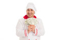 Cook man holding fan of dollars wearing white uniform in the studio over background isolated Royalty Free Stock Image
