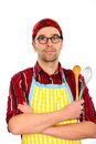 Cook man in kitche outfit with kitchen tools Royalty Free Stock Photography