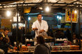 Cook in marrakesh at night a shop on the famous market on the square djema el fnaa morocco Royalty Free Stock Image