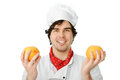 Cook with oranges portrait of a man holding Stock Image