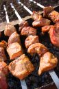 Cook shashlik from meat Stock Photos