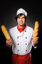 Cook wit loafs an image of young with Stock Photography
