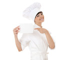 Cook woman pointing on empty card white background Royalty Free Stock Photography