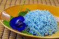 Cooked blue rice made from butterfly pea flower asian pigeonwings good for health Stock Image