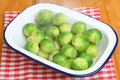 Cooked brussels sprouts in serving dish visible steam rising Stock Photography