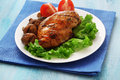 Cooked chicken breast mushrooms blue wooden table Stock Photo