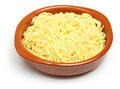 Cooked fresh spaghetti pasta in a terracotta dish Stock Image