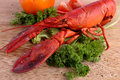 Cooked lobster with various vegetables on wooden board Royalty Free Stock Photos