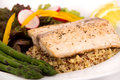 Cooked mahi mahi fish fillet dish on quinoa with vegetables Stock Photos