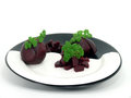 Cooked red turnip on black white plate Royalty Free Stock Photo