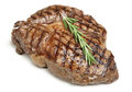 Cooked rib eye steak on white Royalty Free Stock Photos