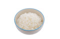 Cooked rice in bowl on white background Royalty Free Stock Photos