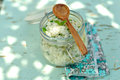 Cooked rice with mint and lemon zest in a jar picnic meal shallow depth of field Stock Photo
