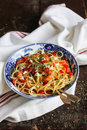 Cooked spaghetti pasta dish with roasted shrimps, chopped fresh tomatoes Royalty Free Stock Photo