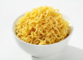 Cooked spaghetti a portion of served without sauce on a white ceramic bowl against a white backdrop Royalty Free Stock Photography