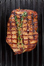 Cooked steak on grill pan Royalty Free Stock Photo