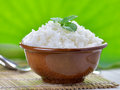 Cooked white rice garnished with mint in a ceramic bowl Stock Photo