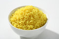 Cooked yellow rice in a bowl portion of white ceramic Royalty Free Stock Image