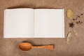 Cookery book with spices on brown parchment backgrownd Royalty Free Stock Photo