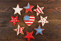 Cookie with american patriotic colors different shapes cookies on the wooden background Stock Photo