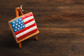 Cookie with american patriotic colors on the easel flag shaped wooden background Royalty Free Stock Photo