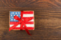 Cookie with american patriotic colors with ribbon flag s shaped cookies on the wooden background Royalty Free Stock Photos