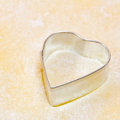 Cookie cutter cookies heart on dough Royalty Free Stock Photography