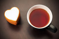 Cookie heart and cup of tea closeup view Royalty Free Stock Photo