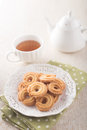 Cookie and tea cup of on the wood desk Stock Photography