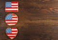 Cookies with american patriotic colors different shapes on the wooden background Stock Photography
