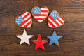 Cookies with american patriotic colors heart shaped on the wooden background Royalty Free Stock Images